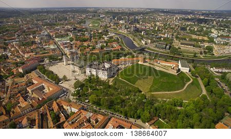 AERIAL. Beautiful sunny day aerial panorama shot of old town in capital of Lithuania Vilnius