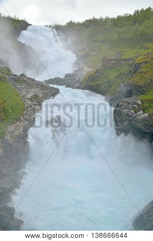 Kjosfossen waterfall along Flam railway in Norway.