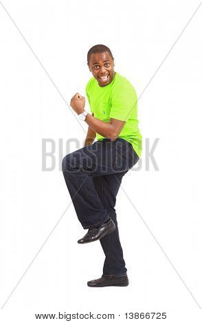 Overjoyed celebrating African American man on white background
