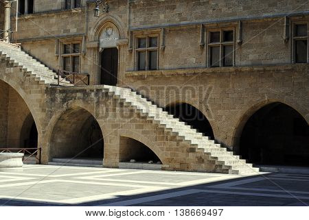 stone staircase in the courtyard of an ancient castle in Rhodes