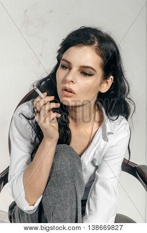 Girl Smokes A Cigarette.