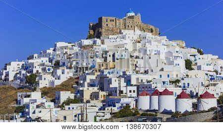 beautiful Astypalea island - view of old castle and Chora with a windmills