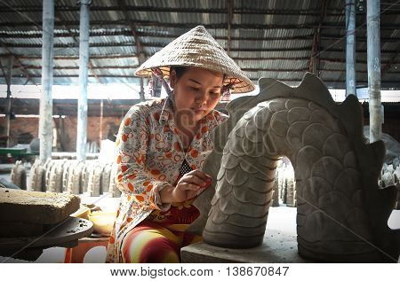 Vinh Long, Vietnam, June 18, 2016 the woman, artisan, clay modeling pottery, traditional pottery village, Vinh Long, Vietnam