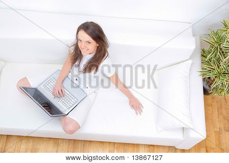 Top view of happy mature lady working on laptop