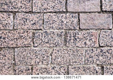Texture of the treated rectangular brown granite tiles