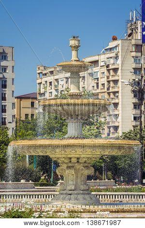 Bucharest central city fountain. Fountain in Unirii Square Bucharest. Water fountains in Unirii Square Romania.