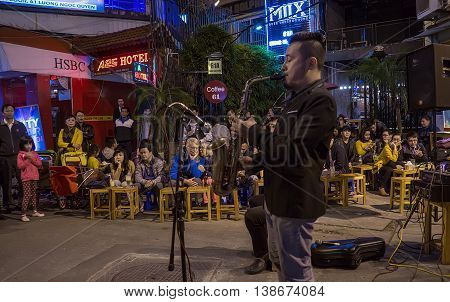 HA NOI, VIET NAM, April 30, 2016 group of musicians playing music, the Old Quarter in Ha Noi, Vietnam, in the evening