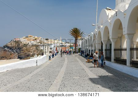Santorini, Greece - April 30, 2016: Quay in the city of Fira, Santorini's capital. Favorite place for tourists walks.