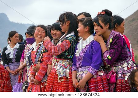 MOC CHAU, VIETNAM, February 9, 2016 Hmong group, highland Moc Chau, sitting embroidered brocade, in the spring