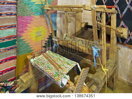 Kaluga, Russia - July 12, 2014, Ancient wooden loom of Russian masters