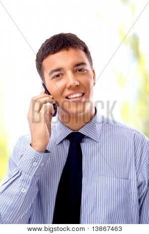Young businessman using mobile phone