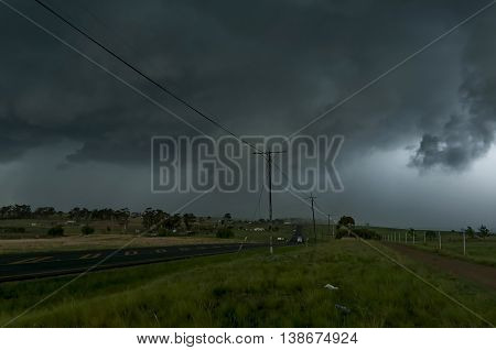 Drakensberg - December 03, 2011: Oncoming hailstorm afternoon in South Africa