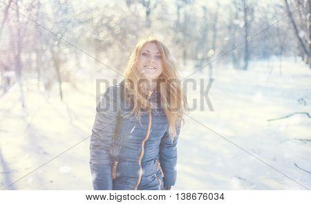 Beautiful girl walking on the snowy weather