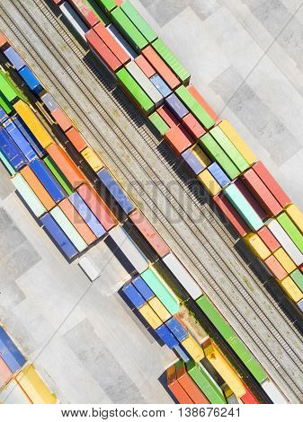Aerial view of storage and freight terminal with containers at railway. Industrial background. Industry from above.