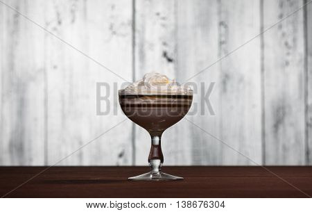 Bowl with cream dessert isolated on white wooden background. Bowl of whipped cream isolated on white background.
