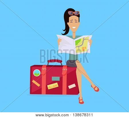Summer vacation concept. Traveling with baggage illustration. Flat style design. Smiling brunette woman seating on suitcase and looking in road map. Isolated on blue background.
