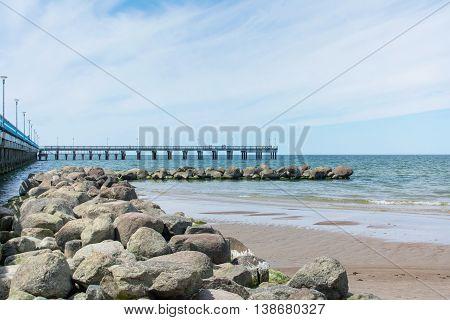 Rocks And Dock Of Palanga Beach In Lithuania