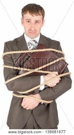 Young sad businessman and briefcase tied with ropes