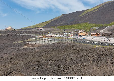Mount Etna with car parking for tourists visiting the vulcano Sicily Italy