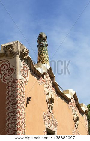 BARCELONA SPAIN - MAY 13 2016 : Decorative facade on Gaudi House Museum with mosaic chimney . Building located near the Park Guell in Barcelona was the residence of Antoni Gaudi for almost 20 years from 1906 to 1925.