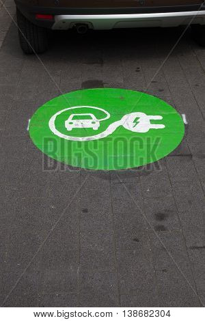 Sign for charging station for electric cars on asphalt