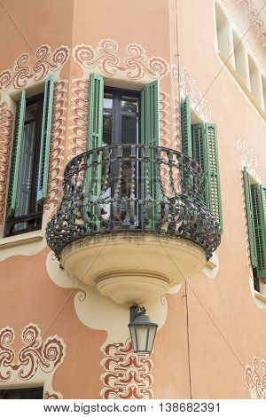 BARCELONA SPAIN - MAY 13 2016 : Facade with metal balcony on Gaudi House Museum. Building located near the Park Guell in Barcelona was the residence of Antoni Gaudi for almost 20 years from 1906 to 1925.