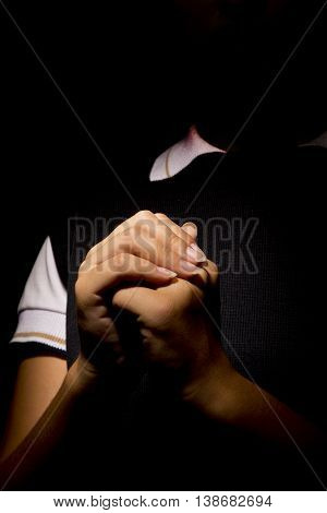 A woman Praying woman Hands in black background