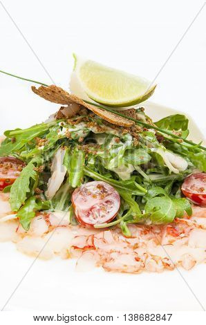 salad greens and shrimp meat on a white background
