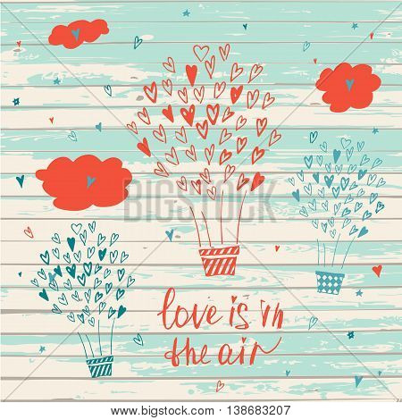 Hand Drawn Typography Poster On Wood Background. Love Is In The