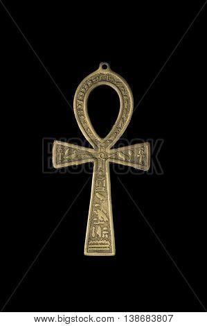 Egyptian symbol of life Ankh isolated on black background