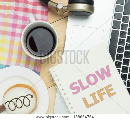 Slow Life on book with Cafe pastel background.