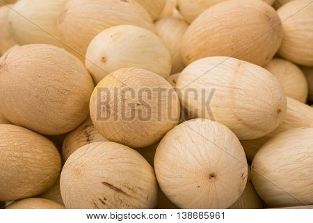 many fresh sweet yellow melons in market