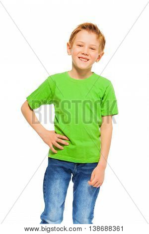 Portrait of smiling seven years old boy in green t-shirt and denim, isolated on white