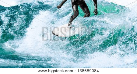 Surfer Rides On Turquoise Ocean Wave