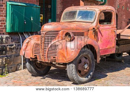 TORONTO CANADA - JULY 1 2016: Old rusty red truck in Distillery District.