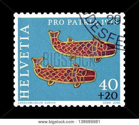 SWITZERLAND - CIRCA 1973 : Cancelled postage stamp printed by Switzerland, that shows Fish fibulae.