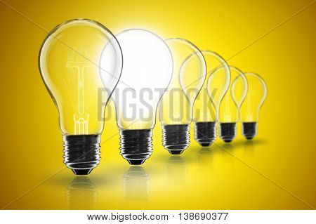 Idea Concept -   Light Bulb On The Black Background