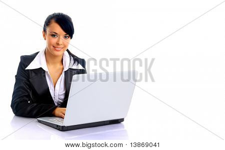 Young business woman on a laptop - isolated on white