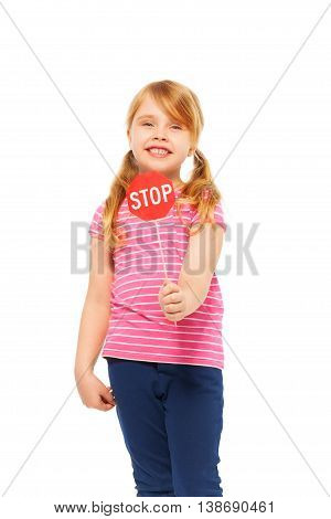Close-up portrait of young fair-haired girl, holding small red Stop sign, isolated on white