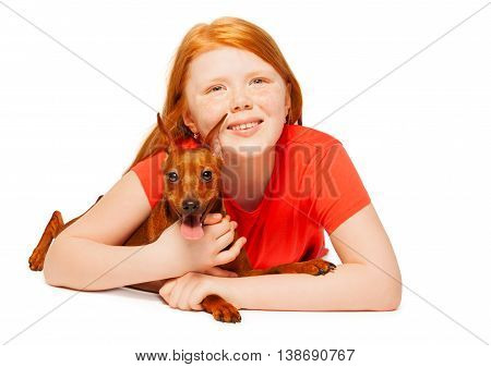 Beautiful red girl lay with red miniature pinscher dog isolated on white