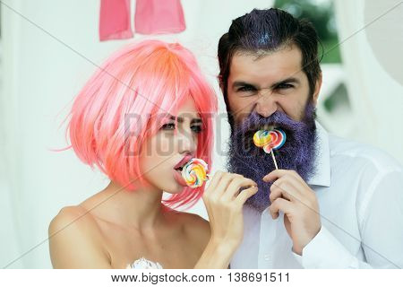 Glamour Couple Eating Lollipop