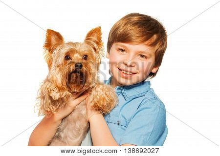 Close-up portrait of smiling blond boy, holding Yorkshire toy terrier, isolated on white background