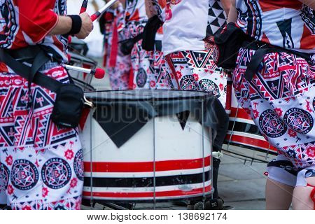 BATH SOMERSET UK - JULY 16 2016 Batala drums and costumes. Bath Carnival procession around the streets of the city of Bath bringing a South American festival atmosphere to Somerset