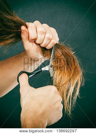 Male Hands Cutting Long Hair