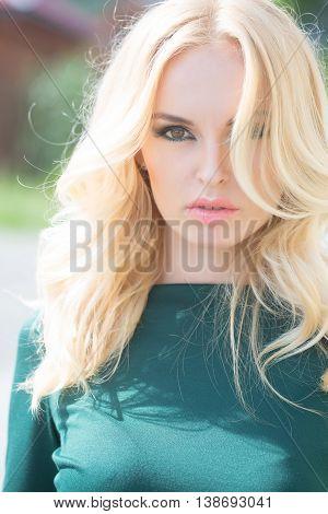 Pretty Blonde Woman In Green Dress
