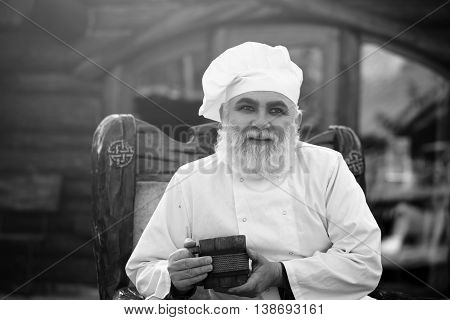 Bearded Cook With Wooden Cup