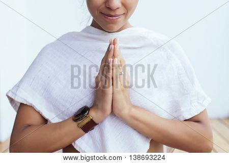 Latin pregnant woman meditating