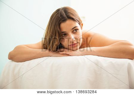 Cute Woman Laying On A Spa Bed And Relaxing