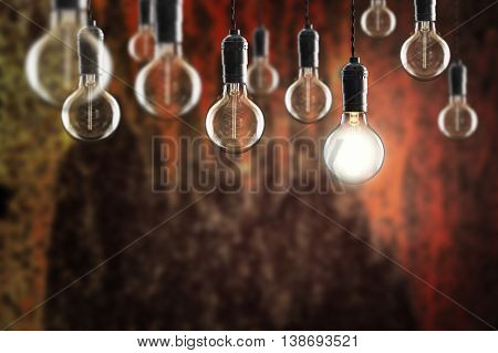 Idea And Leadership Concept -  Bulbs On The Grunge Background