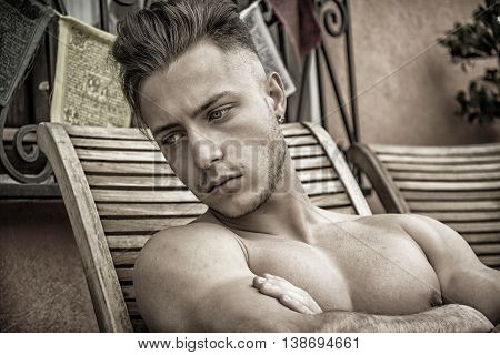 Shirtless Young Man Drying Off in Hot Sun, Muscular Man Sunbathing on Beach Lounge Chair